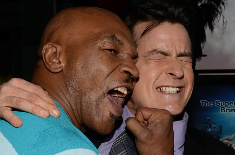 """HOLLYWOOD, CA - APRIL 11:  Former professional boxer Mike Tyson and actor Charlie Sheen arrive for the premiere of Dimension Films' """"Scary Movie 5"""" at ArcLight Cinemas Cinerama Dome on April 11, 2013 in Hollywood, California.  (Photo by Michael Buckner/Getty Images)"""
