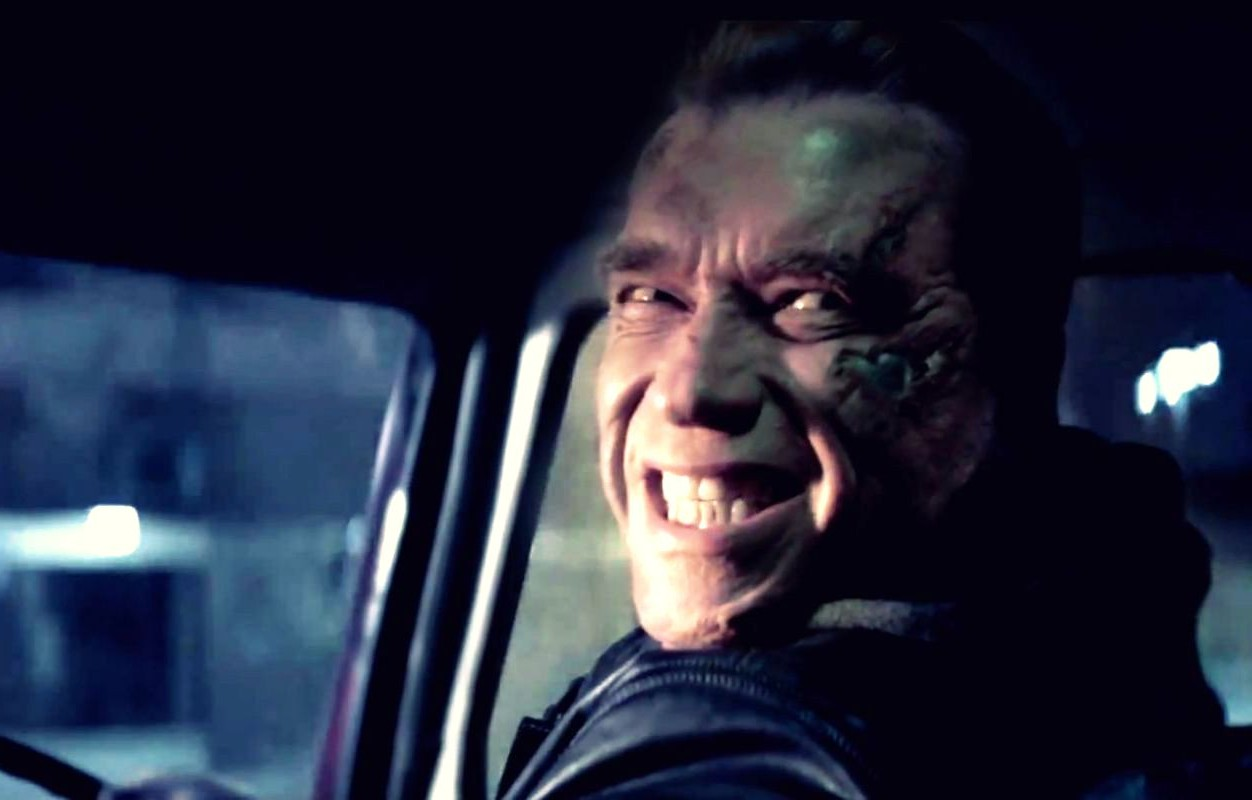 Arnold-Schwarzenegger-smiling-while-driving-car-e1435783086273